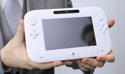 Satoru Iwata satoru iwata wii u gamepad